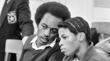 Former fugitives Alton Coleman and Debra Brown confer prior to a brief court appearance Thursday afternoon January 31, 1985 in Cincinnati. A tenative trial date of June 17 has been set for their trial in the murder of Toney Storey. (AP Photo/Al Behrman)
