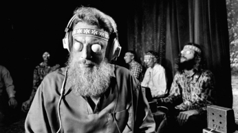 """Head of """"Mind Control"""" Jack Gariss conducting group who are hooked-up to bioscope machines. Location: Los Angeles, CA, US Date taken: March 1972"""